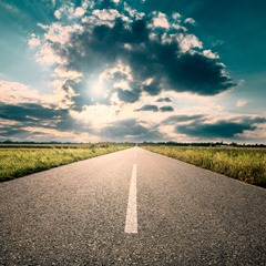 Driving on road towards the setting sun © rasica - Fotolia.com