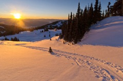 Scenic Mountain Sunset with Ski Track